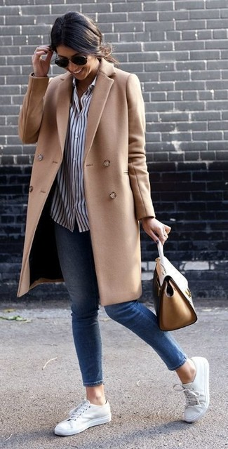How to wear: camel coat, white and navy vertical striped dress shirt, blue skinny jeans, white low top sneakers