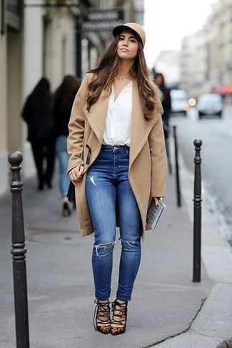 Consider pairing a camel coat with blue ripped skinny jeans for a refined yet off-duty ensemble. Add a glam twist to your outfit with brown leopard suede pumps. With rising temperatures comes a sense of spring renewal and the need for a #{cool} ensemble just like this one.