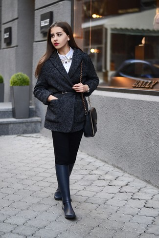 Rock a charcoal herringbone coat with black fitted pants to ooze class and sophistication. Rain boots will add a new dimension to an otherwise classic look.