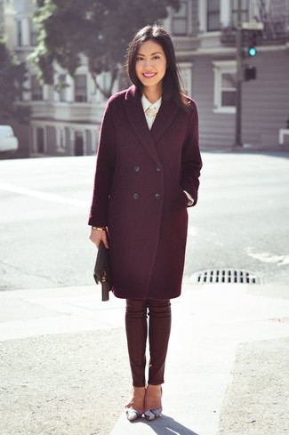 Pair a burgundy coat with oxblood leather slim pants to feel confidently and look fashionably. This outfit is complemented perfectly with grey snake leather pumps.