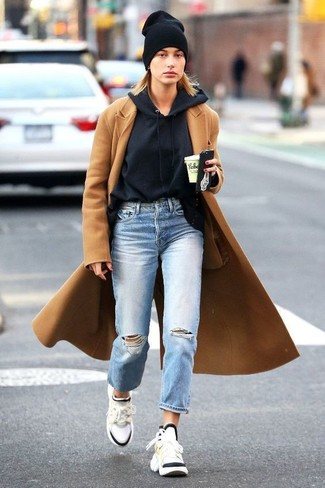 How to wear: camel coat, black hoodie, light blue ripped boyfriend jeans, white athletic shoes