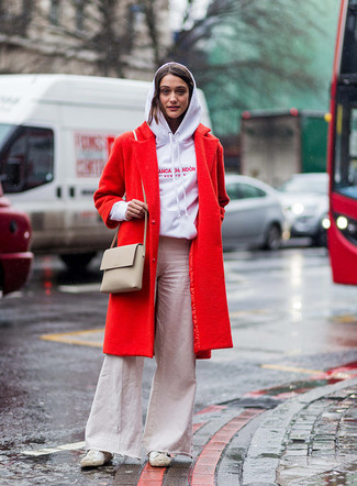How to wear: red coat, white print hoodie, beige flare jeans, white canvas low top sneakers
