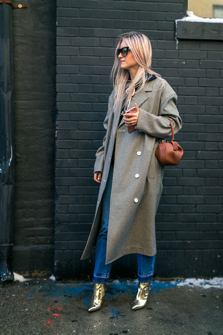 How to wear: grey check coat, black hoodie, blue jeans, gold leather ankle boots