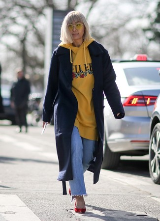 How to wear: navy coat, yellow print hoodie, light blue jeans, red suede pumps