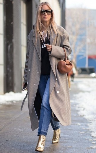 How to wear: grey coat, black and white print hoodie, blue jeans, gold leather ankle boots