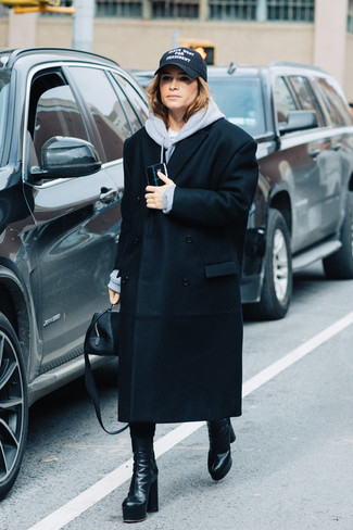 How to wear: black coat, grey hoodie, black leather mid-calf boots, black leather handbag