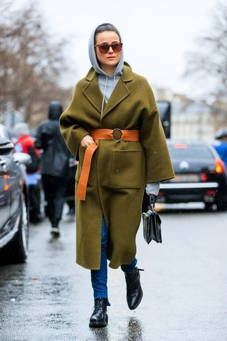 How to wear: olive coat, grey hoodie, blue skinny jeans, black leather lace-up flat boots