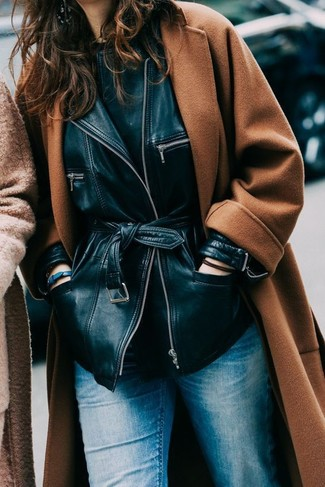 How to wear: tobacco coat, black leather jacket, black crew-neck t-shirt, blue jeans