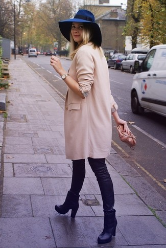 A pink coat and black leather leggings are perfect for both running errands and a night out. Elevate this ensemble with black leather booties.