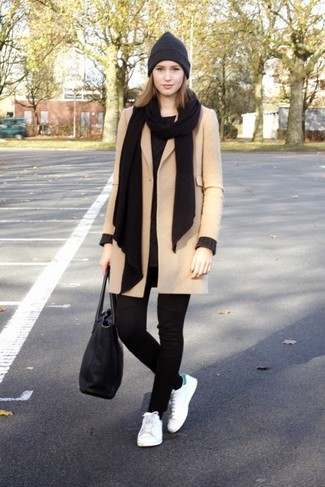 Team a camel coat with black leggings and you'll look like a total babe. A pair of sneakers brings the dressed-down touch to the outfit. So as you can see, it's a chic, not to mention spring-friendly, combo to have in your transeasonal wardrobe.