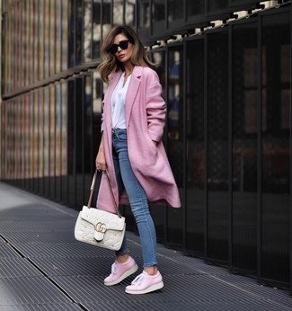 How to wear: pink coat, white long sleeve blouse, blue skinny jeans, pink leather low top sneakers
