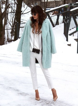 Go for a classic style in a baby blue coat and white skinny pants. A pair of khaki leather pumps will seamlessly integrate within a variety of outfits.