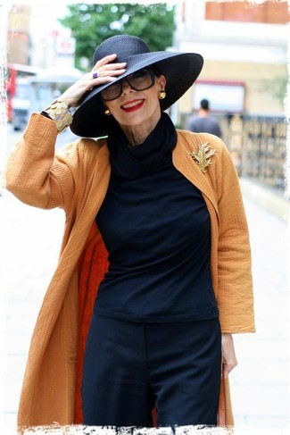 Swing into something classic yet on-trend with an orange coat and a Diesel Wide Brim Sunhat. This getup is ideal for transitional weather.