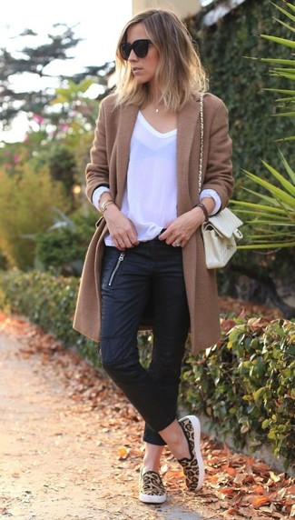 A brown coat and black leather skinny jeans is a great combination to carry you throughout the day. Mix things up by wearing tan leopard slip-on sneakers.