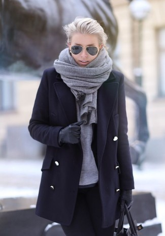 Marry a black coat with black skinny jeans for a glam and trendy getup.