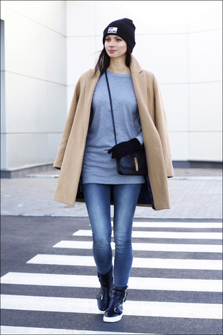 How to wear: camel coat, grey long sleeve t-shirt, blue skinny jeans, black leather high top sneakers