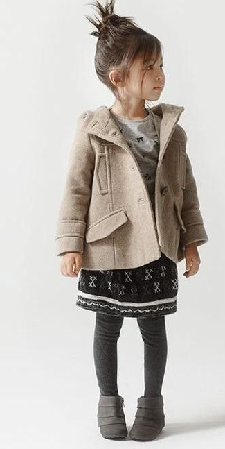 How to Wear a Black Skirt For Girls: The versatility of a beige coat and a black skirt makes them great pieces to have in your little girl's wardrobe'. This style is complemented really well with grey boots.