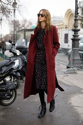 Burgundy Coat Outfits For Women: A burgundy coat and a black print midi dress are must-have staples if you're crafting a casual wardrobe that matches up to the highest fashion standards. When it comes to footwear, this look is finished off nicely with black leather ankle boots.
