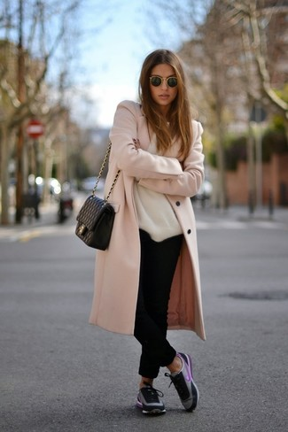 This combo of a dusty pink coat and black chino pants will attract attention for all the right reasons. Choose a pair of black trainers for a more relaxed aesthetic.