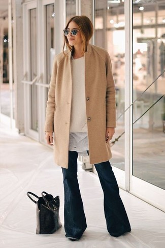 How to wear: camel coat, beige oversized sweater, white crew-neck t-shirt, navy flare jeans