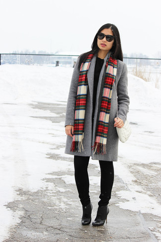 How to wear: grey coat, black oversized sweater, black jeans, black leather ankle boots