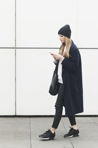 Pairing a dark blue coat with black skinny jeans is a comfortable option for running errands in the city. Mix things up by wearing black athletic shoes.
