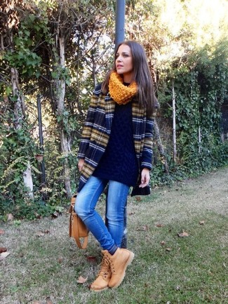 How to wear: navy horizontal striped coat, navy oversized sweater, blue ripped skinny jeans, tan nubuck lace-up flat boots