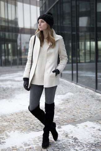 Pair a white coat with dark grey skinny jeans for a glam and trendy getup. A pair of black suede over the knee boots will seamlessly integrate within a variety of outfits.