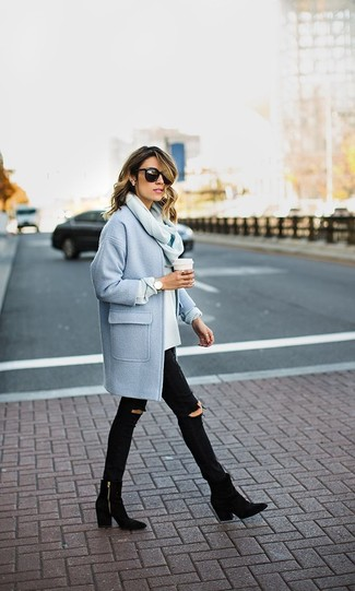 A light blue coat and black destroyed skinny jeans feel perfectly suited for weekend activities of all kinds. Black suede ankle boots are a smart choice to complete the look.