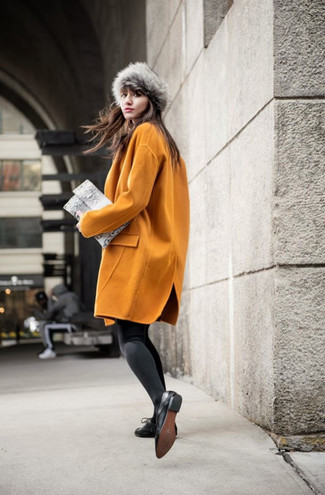How to wear: mustard coat, black leather oxford shoes, grey snake leather clutch, grey fur hat