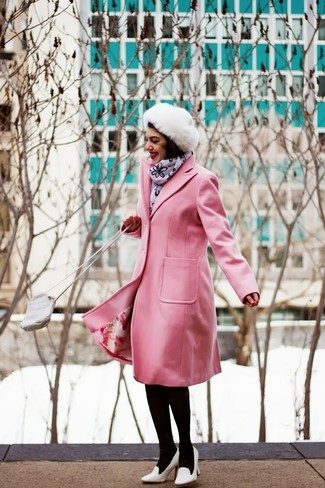 Go for a classic style in a pink coat and a fur hat. White leather pumps are a great choice to complement the look. This getup is absolutely ideal to welcome spring.