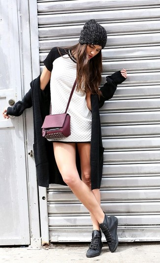 Purple Studded Leather Crossbody Bag Outfits: Pair a black coat with a purple studded leather crossbody bag, if you feel like comfort dressing but also want to look chic. When it comes to footwear, this getup pairs really well with black leather high top sneakers.