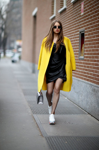How to wear: yellow coat, black satin sheath dress, white low top sneakers, silver leather handbag
