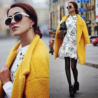 Choose a yellow coat and a monochrome floral shift dress for a seriously stylish look. Complement this look with black chunky leather booties.