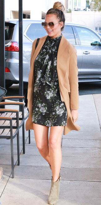 How to wear: camel coat, black floral shift dress, beige suede ankle boots, black fringe leather crossbody bag