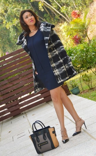 How to wear: black and white plaid coat, navy shift dress, white and black studded leather heeled sandals, black studded leather pumps