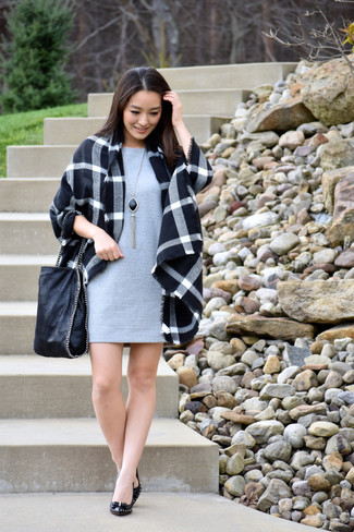 How to wear: black plaid coat, grey shift dress, black leather pumps, black leather tote bag