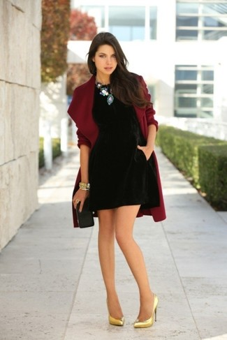 Opt for a black velvet shift dress and a burgundy coat to achieve new levels in outfit coordination. A pair of gold leather pumps will integrate smoothly within a variety of outfits. An ensemble like this makes it easy to embrace weird transitional season.