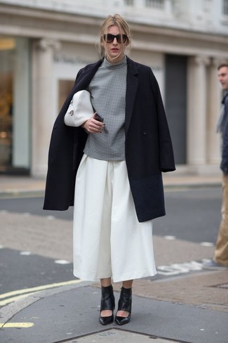 How to Wear a Black Coat For Women: This relaxed combination of a black coat and white culottes takes on different forms depending on how you style it out. Bring a classier twist to your look by sporting black cutout leather ankle boots.