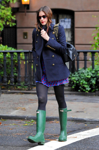 This combo of a navy coat and a blue print skater dress is a safe bet for an effortlessly cool look. For a more relaxed take, choose a pair of green rain boots.