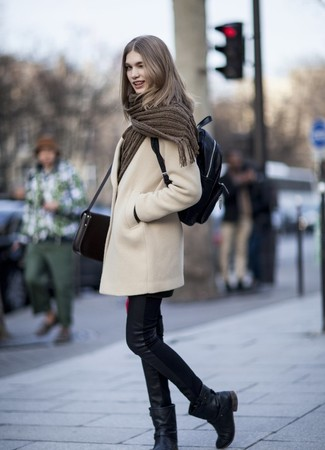 How to wear: beige coat, black leather skinny jeans, black leather mid-calf boots, black leather backpack