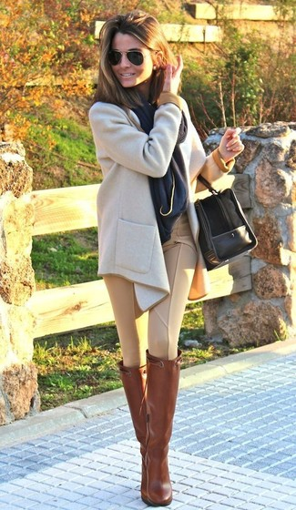 For a look that's nothing less than drool-worthy, consider wearing a beige coat and tan skinny pants. Take your look into a more casual direction with Salvatore Ferragamo Knee Length Boots. Needless to say, a look like this will keep you warm and stylish all season long.
