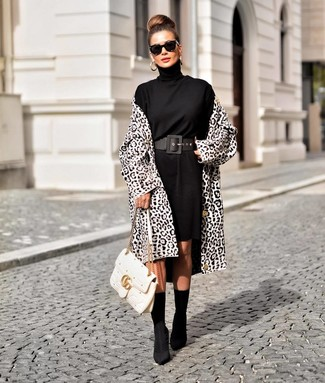 How to wear: white and black leopard coat, black sweater dress, black elastic ankle boots, white quilted leather satchel bag