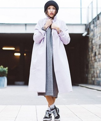 Master the effortlessly chic look in a 525 America women's Cotton Shaker Sweater Dress and a light violet coat. Bring playfulness to your outfit with black canvas high top sneakers. Warmer days call for cooler combos like this one.
