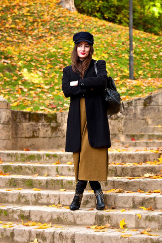 Wear a black coat with a newsboy cap for a seriously stylish look. Black leather ankle boots complement this ensemble very well. This one is an exciting idea when it comes to a kick-ass look that will take you from summer to fall.