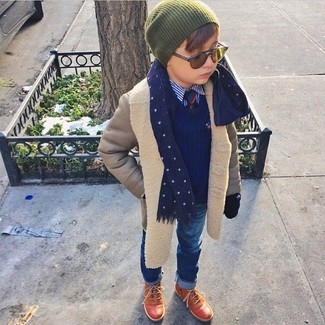 Wearing a grey coat and blue jeans is a great fashion option for your little guy. This getup is complemented really well with brown boots.