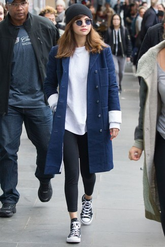 How to wear: navy coat, white sweatshirt, black leggings, black and white high top sneakers