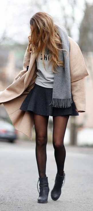 Step up your off-duty look in a khaki coat and a dark grey skater skirt. Black leather booties will add a touch of polish to an otherwise low-key look.