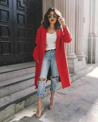 This combination of a red coat and light blue ripped boyfriend jeans gives off a very casual and approachable vibe. Dress up your getup with silver leather heeled sandals. This combo is super functional and will help you out in awkward transition weather.