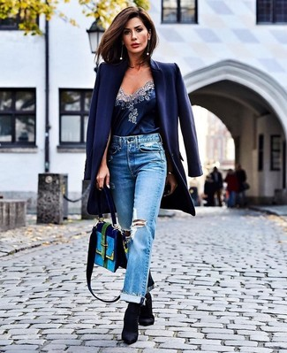 How to Wear Light Blue Ripped Boyfriend Jeans: You'll be surprised at how very easy it is to pull together this off-duty getup. Just a navy coat and light blue ripped boyfriend jeans. A chic pair of black elastic ankle boots is an easy way to add an added dose of chic to your look.